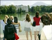 "Tourists enjoy the view of the Leopoldskron castle during ""The Sound of Music"" tour in Salzburg, Austria. In addition to stops at filming locations, the tour has grown to include cultural attractions of the Salzburg region."