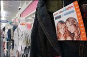 Racks of Mary-Kate and Ashley sportswear for girls are displayed at a Fayetteville, Ark., Wal-Mart store. The giant retailer is trying to gain a bigger foothold in the teen and tween apparel market by joining forces with the Olsen twins, Levi's and others.