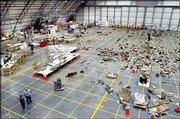 Wreckage of the space shuttle Columbia sits on the floor of a hangar at the Kennedy Space Center in Cape Canaveral, Fla., in this May 22 file photo. NASA officials are seeking advice about what to do with the 84,000 shattered pieces from Columbia, according to reports Sunday.