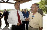 """Former Sen. Bob Dole points out the Medal of Honor worn by Robert Maxwell, Bend, Ore. """"Now there&squot;s a hero,"""" Dole said as he and Maxwell joined other World War II veterans and dignitaries Monday at a luncheon at the Circle S Ranch north of Lawrence. Maxwell grew up in Quinter. The largest gathering in years of Medal of Honor recipients -- 15 -- showed for events surrounding the Dole Institute of Politics dedication. Eleven of them attended a Memory Tent presentation Monday morning at the Dole Institute."""