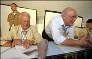 World War II Medal of Honor recipients sign autographs and greet a crowd of visitors during dedication events for the Dole Institute of Politics. From left are Walter Ehlers, Buena Park, Calif., and Hershel Williams, Ona, W.Va. The two participated in a Memory Tent panel discussion.