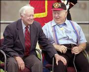 Former President Jimmy Carter, left, and Medal of Honor recipient Jack Lucas sit together during the dedication ceremony for the Dole Institute of Politics. During an earlier event, Lucas told Dole he had always wanted to meet Carter. Dole took time during his speech to introduce them.