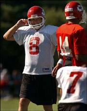 Kansas City kicker Morten Andersen (8) smiles at teammates Eric Warfield and Leo Araguz (7). Andersen, who turns 43 next month, says he can play in the NFL until he is 50, barring injury. The Chiefs practiced Wednesday at River Falls, Wis.