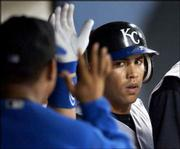 Kansas City's Carlos Beltran is congratulated by teammates in the dugout after his solo home run. Beltran and the Royals pounded Minnesota pitcher Johan Santana in an 8-3 victory Wednesday in Minneapolis.