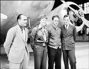 Aviator Amelia Earhart stands with members of her flight team in Honolulu in 1937. From left are Paul Mantz, technical adviser, Earhart, and navigators Harry Manning and Fred Noonan.