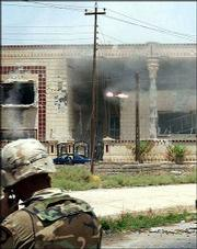 In this handout picture from the U.S. Army, a TOW missile flies toward the building where Saddam Hussein's sons Odai and Qusai were holed up. The two brothers died in a blaze of gunfire and rockets Tuesday when U.S. forces, acting on a tip from an Iraqi informant, stormed the villa in Mosul, Iraq.