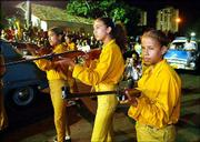 Cuban children re-enact the attack on the Moncada military barracks
