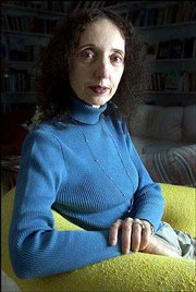 "Author Joyce Carol Oates poses for a portrait in her Princeton, N.J., home in this March 20, 2000, file photo. Oates has almost completely rewritten her 1967 novel, ""A Garden of Earthly Delights,"" for a new hardcover edition published in 2003 by The Modern Library."