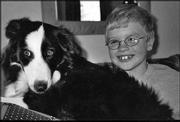 Billy Barnes, 8, Lawrence, hangs out with his 10-month-old border collie puppy, Eleanor.