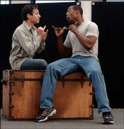 "Actors Tyrone Giordano, left, and Michael McElroy sign a scene during a rehearsal of ""Big River"" in New York. This version of the Tony award-winning musical from California&squot;s Deaf West Theatre is currently appearing on Broadway and includes deaf, hard-of-hearing and hearing actors. Spoken English and American Sign Language (ASL) are interwoven with music, dance and storytelling techniques."