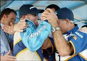 Paul Tracy, left, celebrates with his team after winning the pole at the Molson Indy. Tracy was fastest in qualifying Saturday for today's race at Vancouver, British Columbia.