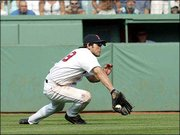 Boston center fielder Johnny Damon makes a diving catch on a fly ball by New York's Jason Giambi, saving a run in the eighth inning of Boston's 5-4 victory at Fenway Park.