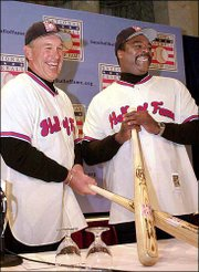 Gary Carter, left, and Eddie Murray conduct a news conference. It formally was announced that the former players would be inducted into the Baseball Hall of Fame during the news gathering Jan. 16 in New York. The 2003 induction ceremonies are today in Cooperstown, N.Y.