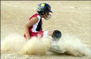 "Tonganoxie's Jessie Whitledge slides safety into third base during the Braves' 3-2 victory over the Lawson (Mo.) Rockettes. Tongie went 2-1 during the American Fastpitch Assn. ""B"" Nationals Saturday at Clinton Lake Softball Complex."