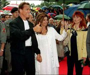 "Austria-born actor Arnold Schwarzenegger and his wife, Maria Shriver, arrive for the German language premiere of his movie ""Batman & Robin"" in Graz, Austria, in this June 20, 1997, file photo. Schwarzenegger has become a national obsession as speculation swirled on whether he might run for governor of California. An adviser said Monday that the actor was leaning against running in the recall election of Gov. Gray Davis."