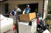 Josh Williamson, a Kansas University senior from Hutchinson, left, and Luke Steinbrink, a senior from Scott City, clean out their former apartment. The pair were preparing Tuesday to move to a new apartment before KU starts up for the fall session.