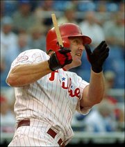 Philadelphia's Jim Thome raps a broken-bat single in the first inning. The Phils beat the Dodgers, 4-2, Wednesday in Philadelphia.