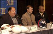 KU coach Mark Mangino, left, and senior captains Bill Whittemnore and Travis Watkins answer questions from the media.