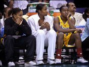 Injured L.a. Sparks standouts Tamecka Dixon, left, and Lisa Leslie, center, sit with forward Mwadi Mabika. San Antonio beat the Sparks, 70-62, Wednesday in Los Angeles.