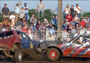Douglas County fairgoers cheer on the wreckage as demolition derby cars collide. The demolition derby was Friday night at the Douglas County Free Fair.