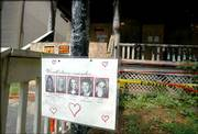 A sign remembering five students killed in an arson fire near the Ohio State University campus still hangs outside the burned house in Columbus, Ohio. Columbus police announced Friday the arrest of Robert Lucky Patterson, 20, who is to be charged with aggravated murder and aggravated arson in the deaths of the five students who died in an early-morning fire April 13. Law enforcement officials say Patterson set fire to a couch on the front porch of the house after stealing radios from cars in the neighborhood.