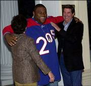 """American Idol"" winner Ruben Studdard is feted by Alabama Gov. Bob Riley, right, and wife, Patsy, left, in February at the Governor&squot;s Mansion in Montgomery, Ala. Studdard has filed suit against the makers of the 205 jerseys he wore on the Fox TV talent show."