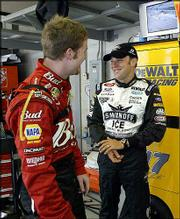 Nascar points leader Matt Kenseth, right, and Dale Earnhardt Jr. chat before practice for the Brickyard 400. The drivers tested the track Friday in Indianapolis.