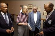 Tuskegee Airmen, from left, John Adams, of Kansas City, Thaddeus Whayne, of Lawrence, Wilson Clemmons, of Kansas City, and Harvey Bayless, of Overland Park, chat before dinner at the Dorsey-Liberty American Legion Post No. 14. The Tuskegee Airmen were in Lawrence to give a talk to the Legion members.