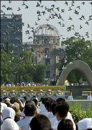 Doves are released into the sky during ceremonies at Hiroshima Peace Memorial Park in Hiroshima, western Japan. Today is the 58th anniversary of the world's first atomic bombing. The landmark Atomic Bomb Dome is seen in the background.