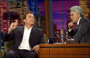 "Actor Arnold Schwarzenegger, left, talks with host Jay Leno during taping of ""The Tonight Show"" in Burbank, Calif. Schwarzenegger announced Wednesday on the show that he would run for governor of California in the recall election scheduled for Oct. 7."