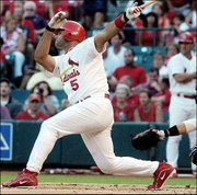 St. Louis' Albert Pujols doubles to score Jim Edmonds in the first inning. The Cardinals beat the Marlins, 3-0, Thursday in St. Louis.