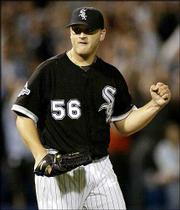 Chicago's Mark Buehrle celebrates after the White Sox defeated Oakland. Buehrle pitched a complete game as the White Sox edged the A's, 3-2, Friday night in Chicago.