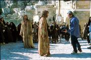 "Mel Gibson, right, directs Jim Caviezel, center, and Caviezel&squot;s double, left, on the set of ""The Passion"" in this Jan. 24 photo. Seven months before its release, Gibson&squot;s self-made film is raising concerns over his exclusionary screenings and his depiction of Jews."