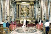 Peter Jasse and Marlo Angell-Jasso stand at the alter during their wedding at the Pauline or Borghese Chapel in the Basilica of Santa Maria Maggiore in Rome.
