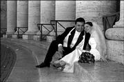 Peter Jasso and Marlo Angell-Jasso pose for a picture on their wedding day at St. Peter's Square.