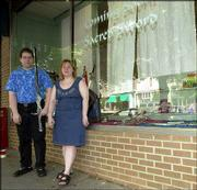 Gary Shainheit, left, and Dawn Rothwell stand in front of their business Sacred Sword. Sacred Sword, 732 Mass., will sell swords, knives and daggers along with herbs, tarot cards and other fantasy products.