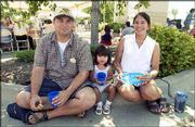 Dennis Blackwood, Lawrence, left, his daughter, Isabelle, 2, and his wife, Carole, attend Lawrence Memorial Hospital's community picnic. The picnic was Sunday at LMH South.