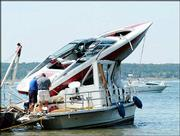 A boating accident left a Mission woman dead and two injured Meriden men transported to area hospitals. The Friday night accident occurred at the entrance to Perry Marina, just outside the no-wake zone, and resulted in a motorboat landing on top of a houseboat. Officials are investigating the cause of the collision.
