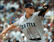 Seattle's Gil Meche delivers against New York. Meche allowed two hits in eight innings, and the Mariners defeated the Yankees, 2-1, Saturday in New York.