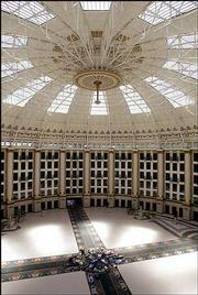 Visitors lie on their backs to get a better look at the glass-and-steel domed atrium that rises 100 feet above the mosaic-tiled floor of the West Baden Springs Hotel in West Baden, Ind. The hotel, which is a century old and a National Historic Landmark, was collapsing into ruins until restoration work began in 1996.