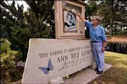 JOHN GURKIN cleans the glass protecting a photograph of his wife, Ann, above a marble sign in her honor.