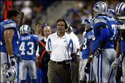 Detroit coach Steve Mariucci walks the sideline during the Lions game against Pittsburgh. The Lions won their exhibition game -- their first with their new coach -- Saturday at Detroit.
