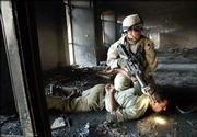 A U.S. soldier arrests an Iraqi man caught robbing the vaults of a burned-out bank in central Baghdad in this April 16 file photo. Iraqis say that there is no greater humiliation for an Islamic man than forcing his forehead to the ground because Islam forbids putting the forehead on the ground except in prayer. Such Islamic cultural taboos by the U.S. military are fueling anti-American sentiment, many Iraqis contend.