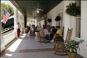 Visitors relax in rockers on the wide porch of the French Lick Springs Resort and Spa in French Lick, Ind. The opening of a nearby riverboat casino is expected to bring additional visitors to the area.