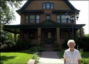 Linda O'Hara stands in front of her Garden City home, where she has been living for nine years with her husband, Paul. The 1909 home is listed on the National Register of Historic Places.