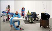 """Nursing Home,"" by French artist Gilles Barbier, includes wax figures of ailing comic book characters, shown in this undated publicity photo. The multimedia installation is among the works by 47 artist from 47 countries in the exhibit ""The American Effect,"" running through Oct. 12 at the Whitney Museum of American Art in New York."