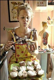 "Writer, actress and comedian Amy Sedaris frosts cupcakes, which she sells to a nearby coffee shop, in the kitchen of her New York apartment. Sedaris has a new book out called ""Wigfield."" She also has played roles in ""Sex and the City,"" the film ""Maid in Manhattan"" and Comedy Central&squot;s ""Strangers With Candy."""