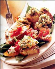 "Goat Cheese & Tomato Bruschetta, from ""Good Housekeeping Grilling Cookbook"" (Hearst Books, 2003, $19.95), is a tasty twist to the traditional tomato bruschetta recipe."