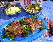 Grilled T-bone steaks inspire debate over whether marinades or dry rubs produce the tastiest steaks.