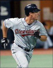 Cleveland's Ryan Ludwick watches the first of his two home runs. Ludwick's homers helped the Indians defeat Minnesota, 9-6, Tuesday night in Minneapolis.